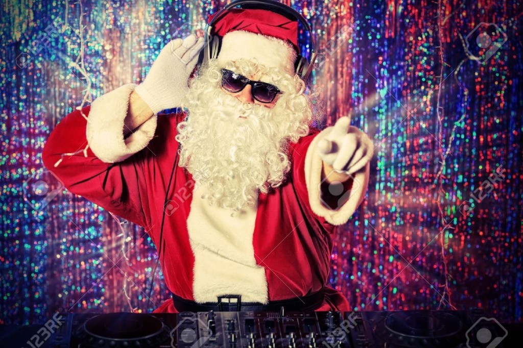 16740097-DJ-Santa-Claus-mixing-up-some-Christmas-cheer-Disco-lights-in-the-background--Stock-Photo